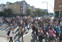 Protestors march on Clay street as they stop traffic in Oakland, Calif., on Sunday, July 14, 2013. A jury ruled yesterday that defendant George Zimmerman has been found not guilty in the shooting death of Trayvon Martin. (Jose Carlos Fajardo/Bay Area News Group)